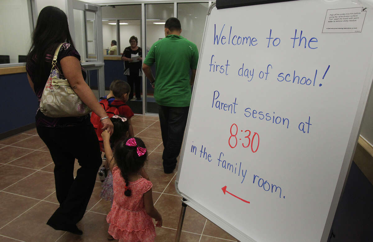 Parents and students enter school Monday August 26, 2013 at the Pre-K 4 SA North Education Center on the first day of school. The initiative will provide full-day Pre-K education programs for an estimated 22,000 four-year-olds over eight years.