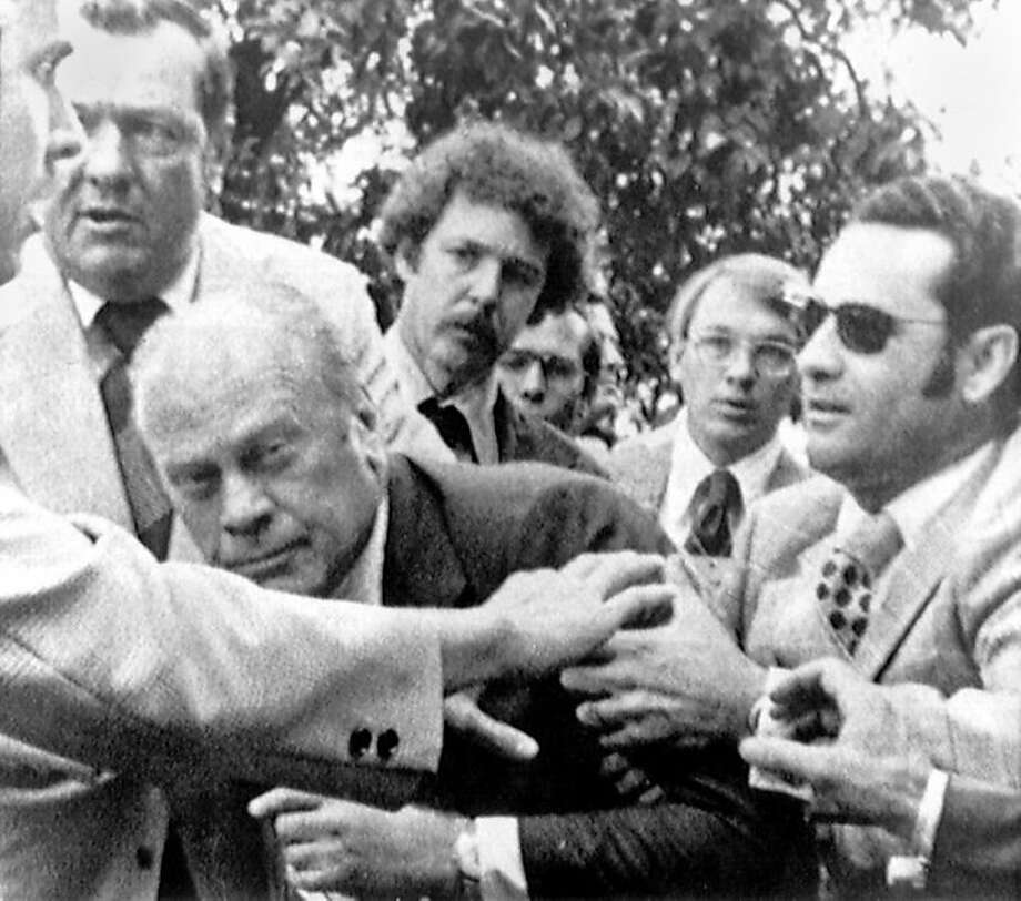 September 5, 1975: On the northern grounds of the California State Capitol, Lynette Fromme, a follower of Charles Manson, drew a Colt M1911 .45 caliber pistol on President Gerald R. Ford when he reached to shake her hand in a crowd. She had four cartridges in the pistol's magazine but none in the firing chamber. She was quickly restrained by Secret Service agent Larry Buendorf. Fromme was sentenced to life in prison, but was released from custody on August 14, 2009 (2 years and 8 months after Ford's death).From Wikipedia Photo: Associated Press