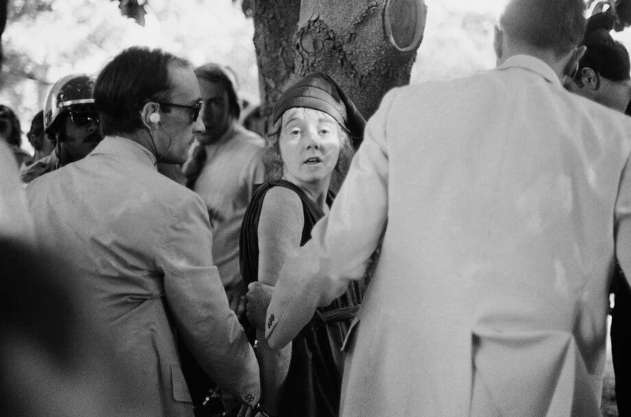 "U.S. Secret Service agents put handcuffs on Lynette ""Squeaky"" Fromme after she pointed at President Gerald Ford in Sacramento. Fromme, a devoted follower of the infamous Charles Manson, wearing a red robe, stepped out from behind a tree and pointed a loaded pistol at the President. Photo: Uncredited, Associated Press"