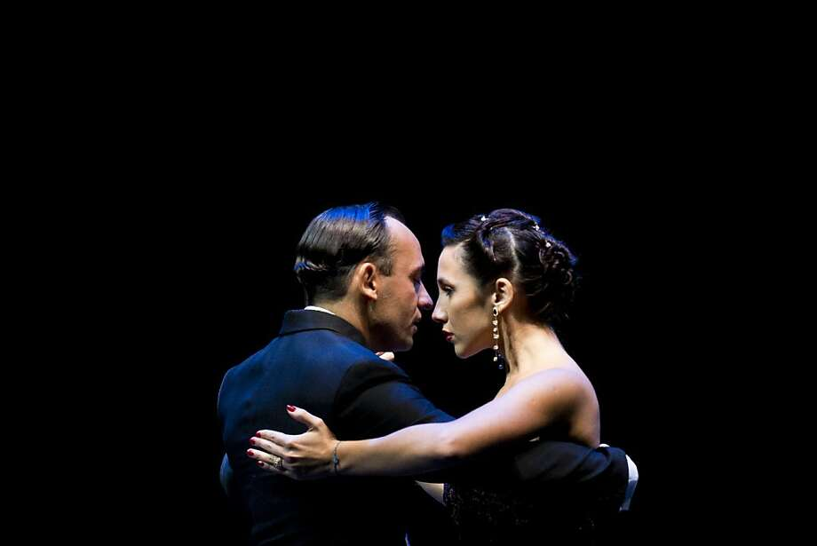 Dancers Maximiliano Cristiani, left, and Jesica Arfenoni, perform to win the 2013 Tango Dance World Cup salon finals in Buenos Aires, Argentina, Monday, Aug. 26, 2013. (AP Photo/Victor R. Caivano) Photo: Victor R. Caivano, Associated Press