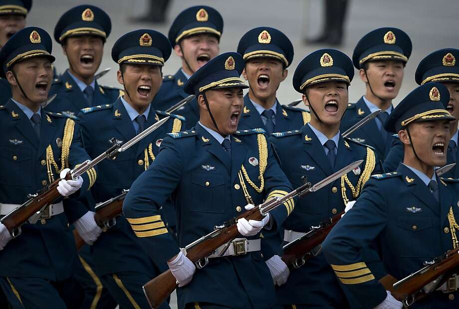 Members of a guard of honor yell as they march at a welcome ceremony for visiting Serbian President Tomislav Nikolic outside the Great Hall of the People in Beijing Monday, Aug. 26, 2013. (AP Photo/Andy Wong) Photo: Andy Wong, Associated Press