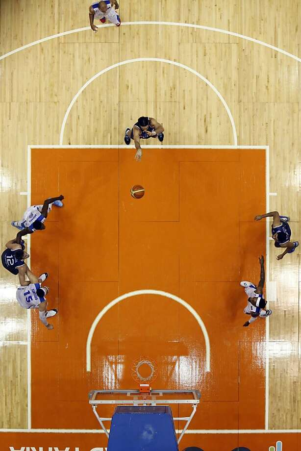 Argentina's Luis Scola, center, shots a free throw during a basketball game in the Tuto Marchand Cup against Puerto Rico in San Juan, Puerto Rico, Monday, Aug. 26, 2013. (AP Photo/Ricardo Arduengo) Photo: Ricardo Arduengo, Associated Press