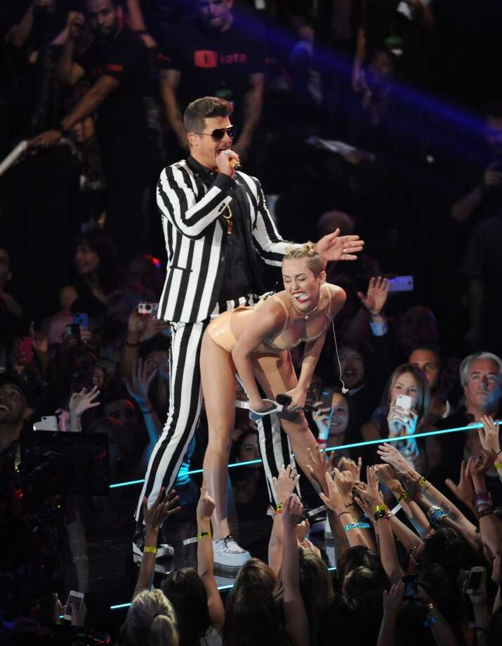 Miley Cyrus goes to twerk on Robin Thicke during the MTV Video Music Awards. Photo: Scott Gries, Associated Press