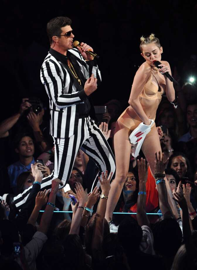 "Robin Thicke, left, and Miley Cyrus perform ""Blurred Lines"" at the MTV Video Music Awards on Sunday, Aug. 25. Photo: Charles Sykes, Associated Press"