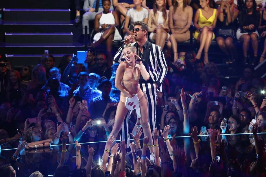 Miley Cyrus and Robin Thicke performs onstage during the 2013 MTV Video Music Awards. Photo: Neilson Barnard, Getty Images For MTV