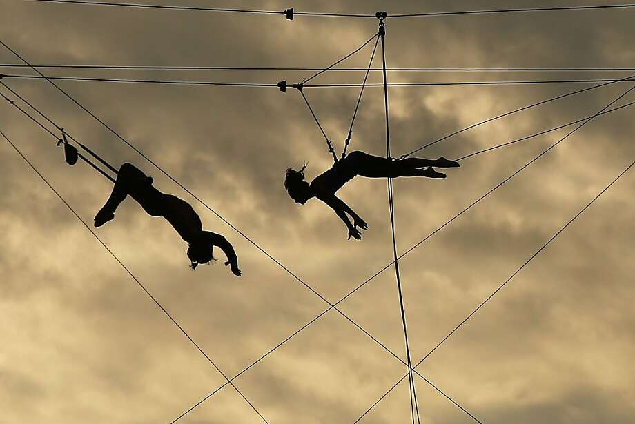 NEW YORK, NY - AUGUST 26:  Participants practice on a trapeze at  the Trapeze School of New York on the West Side of Manhattan beside the Hudson River on August 26, 2013 in New York City. Over recent years, much of the West Side of Manhattan along the river has been re-developed into parks, restaurants and walking paths.  (Photo by Spencer Platt/Getty Images) Photo: Spencer Platt, Getty Images