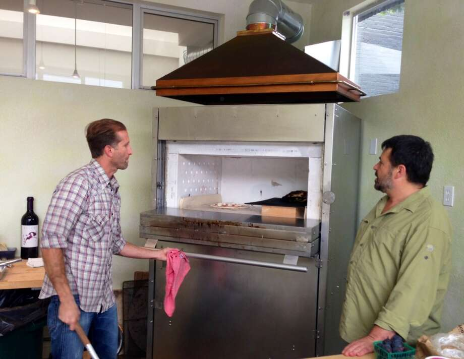 Pizza master Jeff Krupman  and David Vardy at the oven