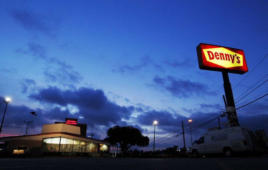 Houston police say one suspect waited in a minivan while three gunmen robbed the Denny's restaurant on Washington at Interstate 10, leaving one person dead and another wounded. The suspects are still at large. Photo: Cody Duty, Houston Chronicle