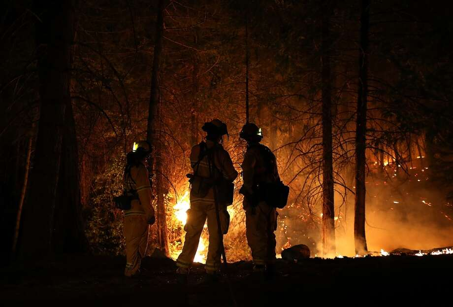 Firefighters from Cosumnes Fire Department monitor a back fire while battling the Rim Fire on August 22, 2013 in Groveland, California. The Rim Fire continues to burn out of control and threatens 2,500 homes outside of Yosemite National Park. Photo: Getty Images