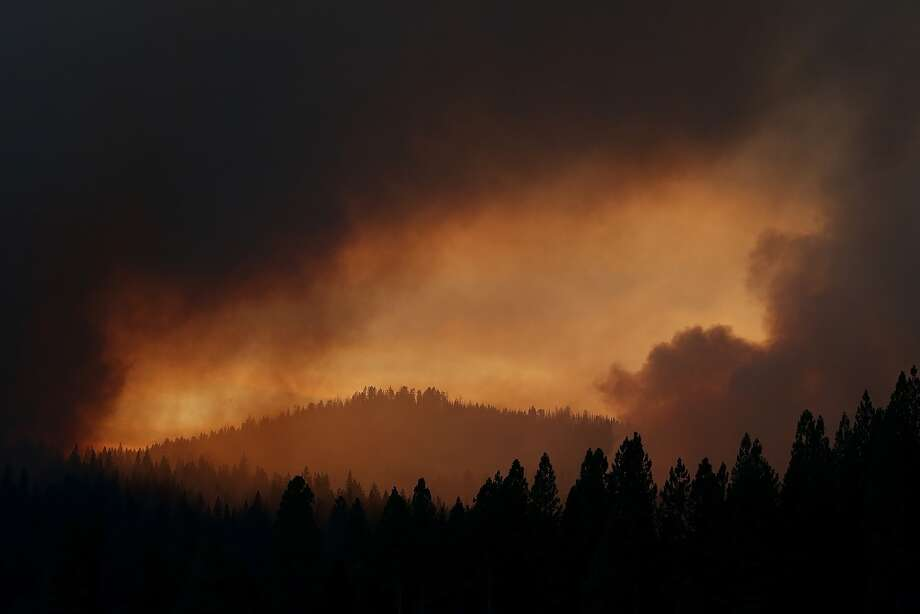 Smoke from the Rim Fire fills the sky on August 24, 2013 near Groveland, California. The Rim Fire continues to burn out of control and threatens 4,500 homes outside of Yosemite National Park. Photo: Getty Images
