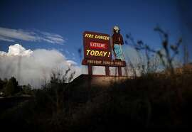 A Smokey the Bear sign is posted along US highway 120 as the Rim Fire burns out of control on August 21, 2013 in Groveland, California. The Rim Fire continues to burn out of control and threatens 2,500 homes outside of Yosemite National Park.