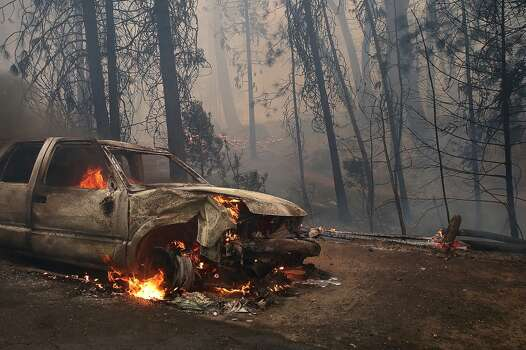 A burned car sits on the side of the road after being consumed by the Rim Fire on August 25, 2013 near Groveland, California. The Rim Fire continues to burn out of control and threatens 4,500 homes outside of Yosemite National Park. Photo: Getty Images