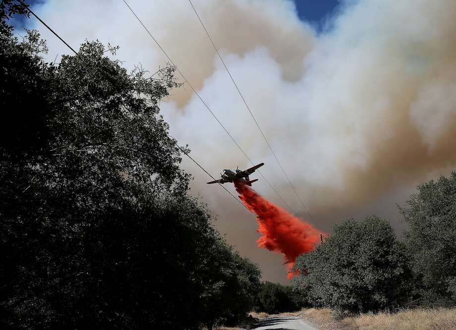 An air tanker drops fire retardant on a ridge ahead of the advancing Rim Fire on August 22, 2013 in Groveland, California. The Rim Fire continues to burn out of control and threatens 2,500 homes outside of Yosemite National Park. Photo: Justin Sullivan, Getty Images
