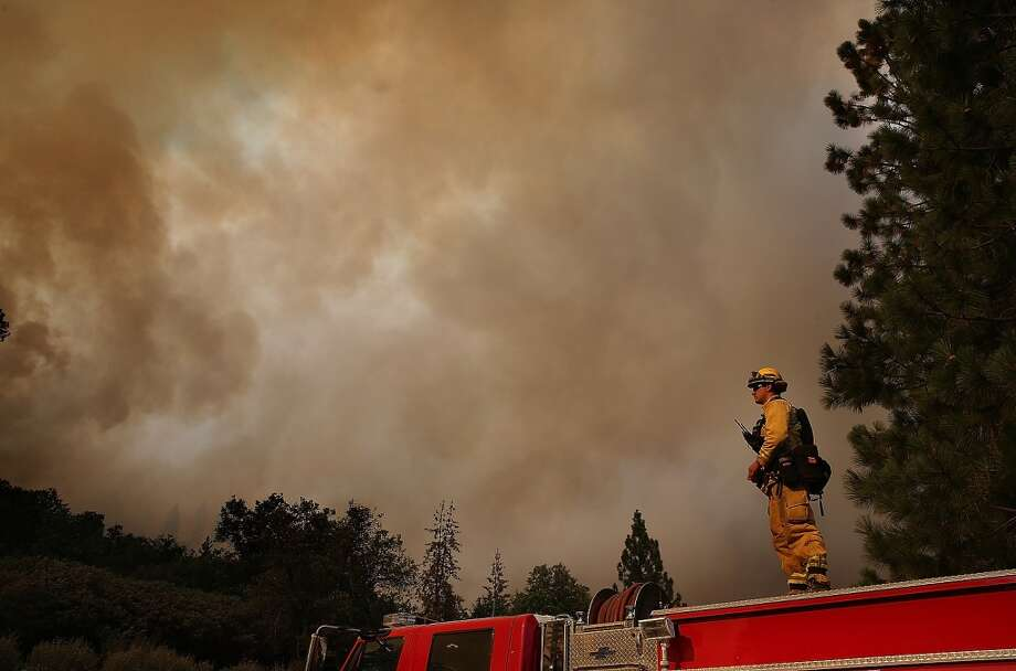 A member of the West Stanislaus County Fire Department monitors the Rim Fire along highway 120 on August 24, 2013 near Groveland, California. Photo: Justin Sullivan, Getty Images
