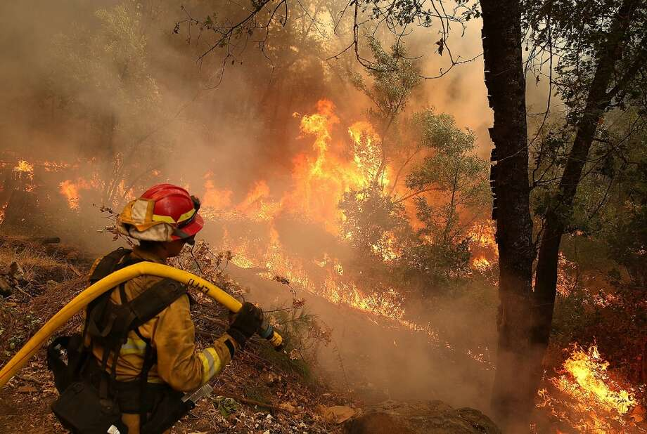 A firefighter from Ebbetts Pass Fire District monitors a back fire as he battles the Rim Fire on Aug. 21, 2013 in Groveland, Calif. The Rim Fire threatened 2,500 homes outside of Yosemite National Park. Photo: Justin Sullivan, Getty Images