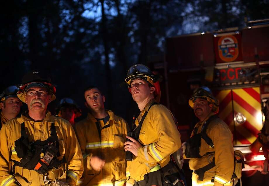 Firefighters from Ebbetts Pass Fire District monitor a back fire while battling the Rim Fire on August 21, 2013 in Groveland, California. The Rim Fire continues to burn out of control and threatens 2,500 homes outside of Yosemite National Park. Photo: Justin Sullivan, Getty Images