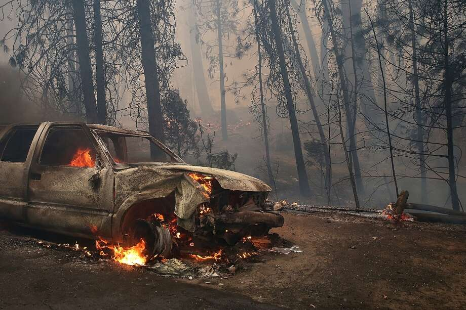 A burned car sits on the side of the road after being consumed by the Rim Fire on August 25, 2013 near Groveland, California. The Rim Fire continues to burn out of control and threatens 4,500 homes outside of Yosemite National Park. Photo: Justin Sullivan, Getty Images