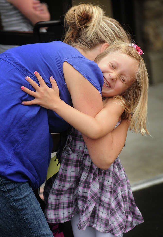 Erin McGee, of Monroe, hugs her daughter Ella, 5, goodbye before her first day of kindergarten outside Monroe Elementary School in Monroe, Conn. on Tuesday, August 27, 2013. Photo: Brian A. Pounds / Connecticut Post