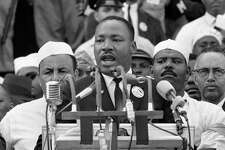 "In this Aug. 28, 1963, black-and-white file photo Dr. Martin Luther King Jr. addresses marchers during his ""I Have a Dream"" speech at the Lincoln Memorial in Washington. Former South African president Nelson Mandela never met with King but the two fought for the same issues at the same time on two different continents. Mandela said in a 1964 speech that he was prepared to die to see his dream of a society where blacks and whites were equal become reality. King was killed by an assassin's bullet while working for that same dream."
