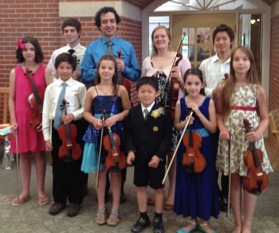 Yaroslav Kargin, who has a music studio in New Canaan, and some of his students recently performed at Waveny Care Center. Photo: Contributed