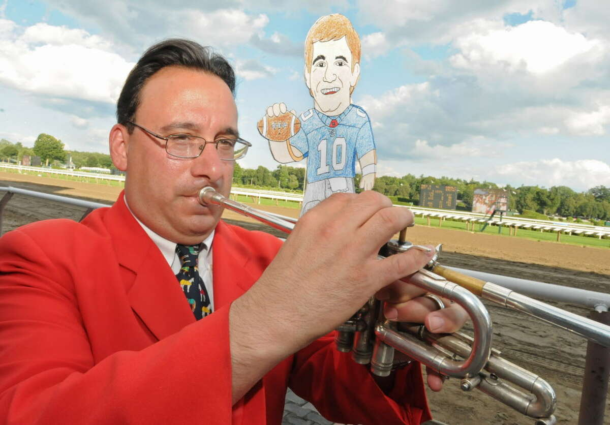 Flat Eli (Manning) poses with Sam the Bugler at the Saratoga Race Course in Saratoga Springs, NY on July 30, 2010. (Lori Van Buren / Times Union) ORG XMIT: MER2013082711323464