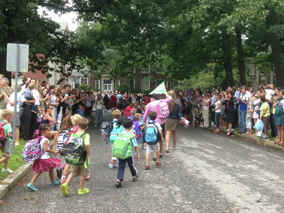 The Parade of Learners marches into Riverside School for the first day of the new school year. Photo: Greenwich Time