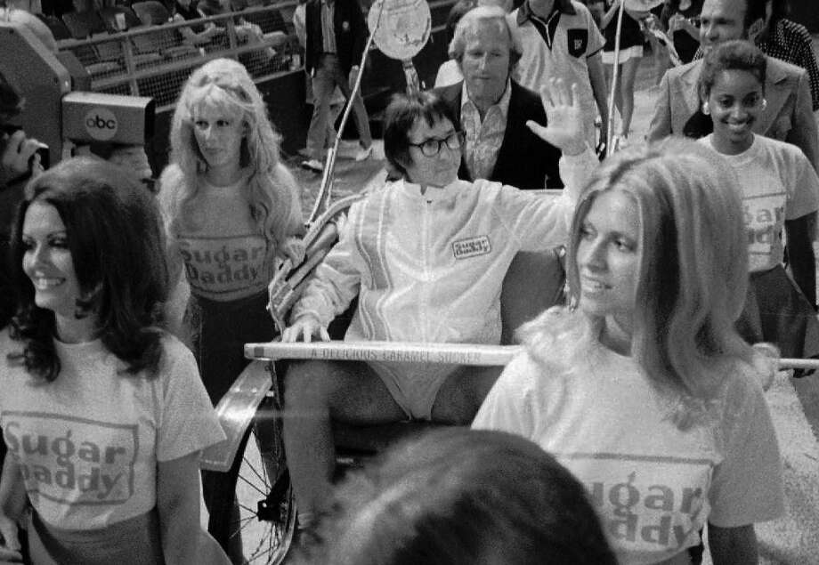 "Bobby Riggs rides in a carriage pulled by women in his grand entrance to the Astrodome in Houston, Tx., for his $100,000 winner-take-all ""Battle of the Sexes"" match against Billie Jean King, Sept. 21, 1973.[ Photo: AP"