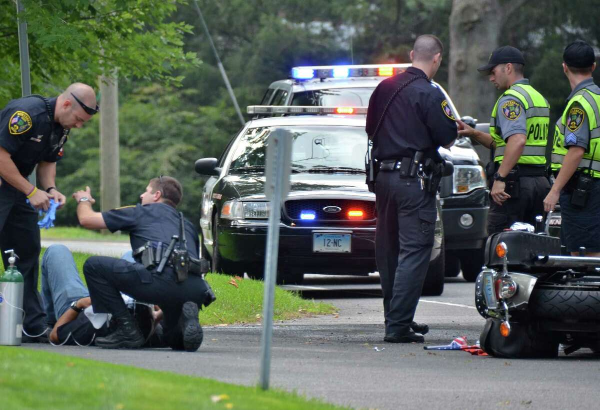 New Canaan police officer Aaron LaTourette was seriously injured in a two-vehicle crash on Oenoke Ridge Road, Tuesday, August 27, 2013.