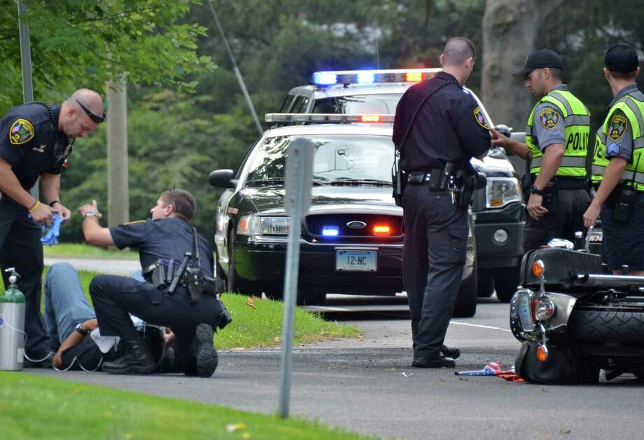 New Canaan police officer Aaron LaTourette was seriously injured in a two-vehicle crash on Oenoke Ridge Road, Tuesday, August 27, 2013. Photo: Jeanna Petersen Shepard / New Canaan News Freelance