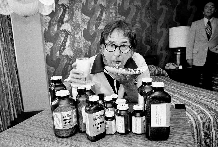 Former world tennis champion Bobby Riggs is seen as he takes his vitamins and supplements as part of his training program for his match with Billie Jean King, Sept. 18, 1973.  Riggs takes about 415 pills a day. Photo: Ed Kolenovsky, AP