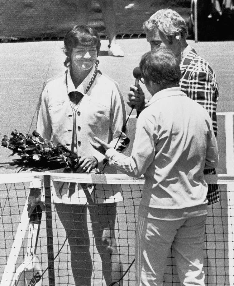 "Margaret Court of Australia, the world's greatest woman tennis player, is startled and smiling as Bobby Riggs (foreground) presents her with a bouquet of Red roses on May 13, 1973 just before the start of their celebrated match game at Ramona, Calif., May 13, 1973. Riggs then commented the gesture might ""soften her up"". He won, 6-2, 6-1. Photo: AP"