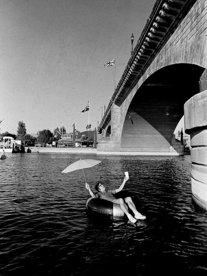 Former world tennis champ Bobby Riggs, who had threatened to jump off a bridge if he lost his tennis match to Billie Jean King, settles for floating under the London Bridge at Lake Havasu City, Ariz., Oct. 10, 1973.  He said he'd been warned he'd be arrested if he tried jumping.  Riggs was beaten by Mrs. King in three straight sets in Houston's Astrodome. Photo: Anonymous, ASSOCIATED PRESS