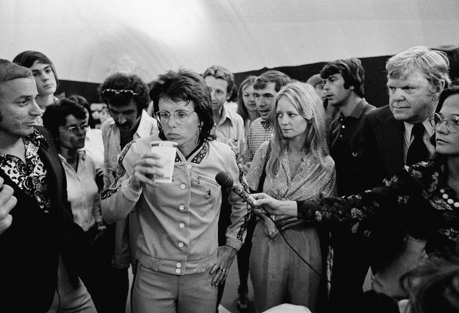 Billie Jean King, center, surrounded by media Sept. 19, 1973 for a round of interviews and promotional work for the up coming match with Bobby Riggs, $100,000 winner take all match with Billie Jean King. Photo: EFK, AP