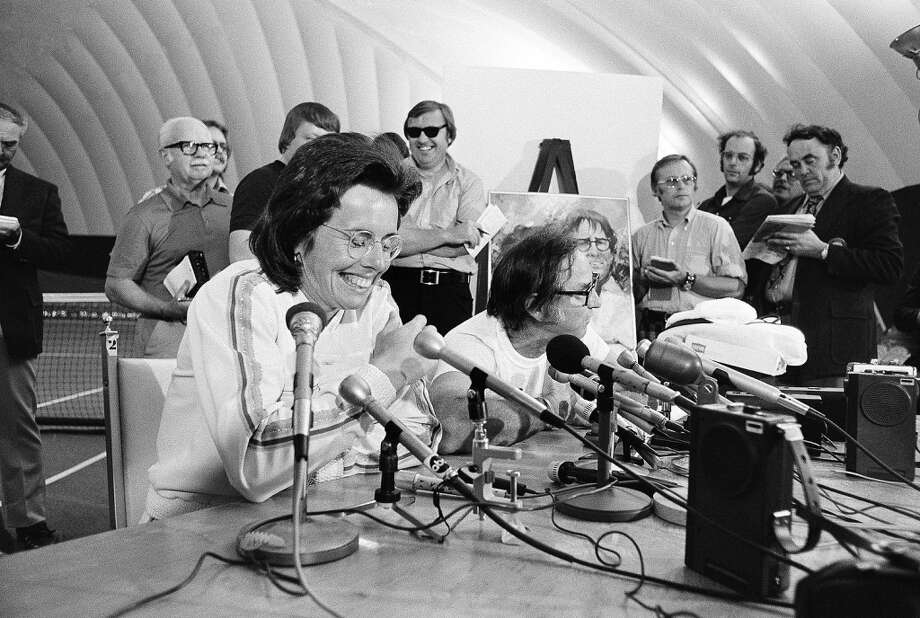 Billie Jean King, left, and Bobby Riggs answer questions at press conference following their match in the Houston Astrodome Sep. 20,1973. King demolished the 55 year old Riggs. Photo: Anonymous, AP