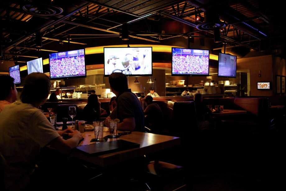 For an upscale sports bar, try Cover 3, 1806 NW Loop 1604, 210-479-9700, cover-3.com Photo: Xelina Flores-Chasnoff, For The Express-News / San Antonio Express-News