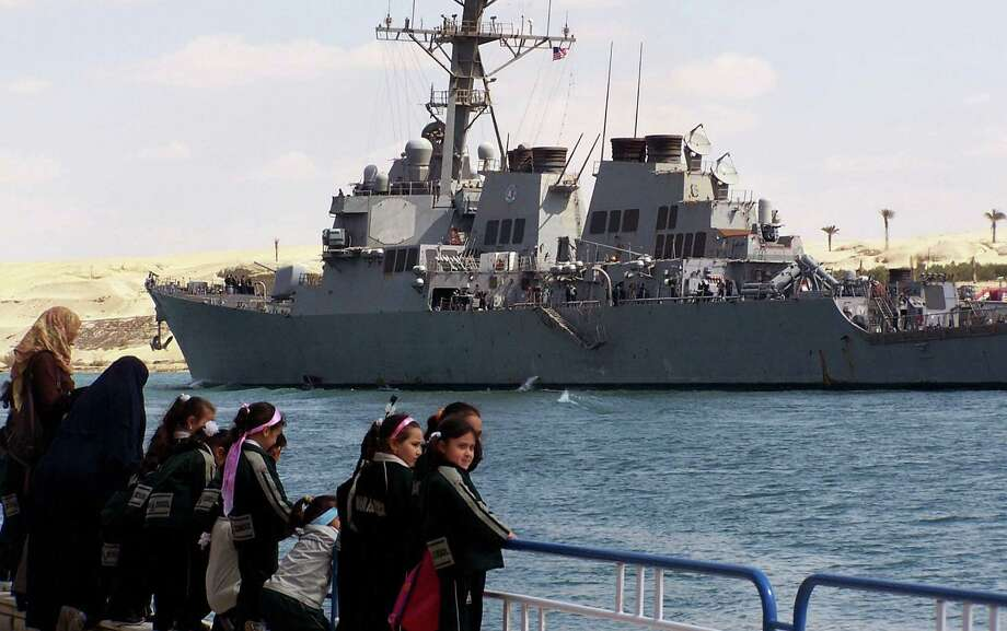 The Navy normally maintains a presence in the region with two destroyers, but they have quietly steamed in two more. Pictured is the USS Mahan, on scene in Middle East. Photo: -, File / 2009 AFP
