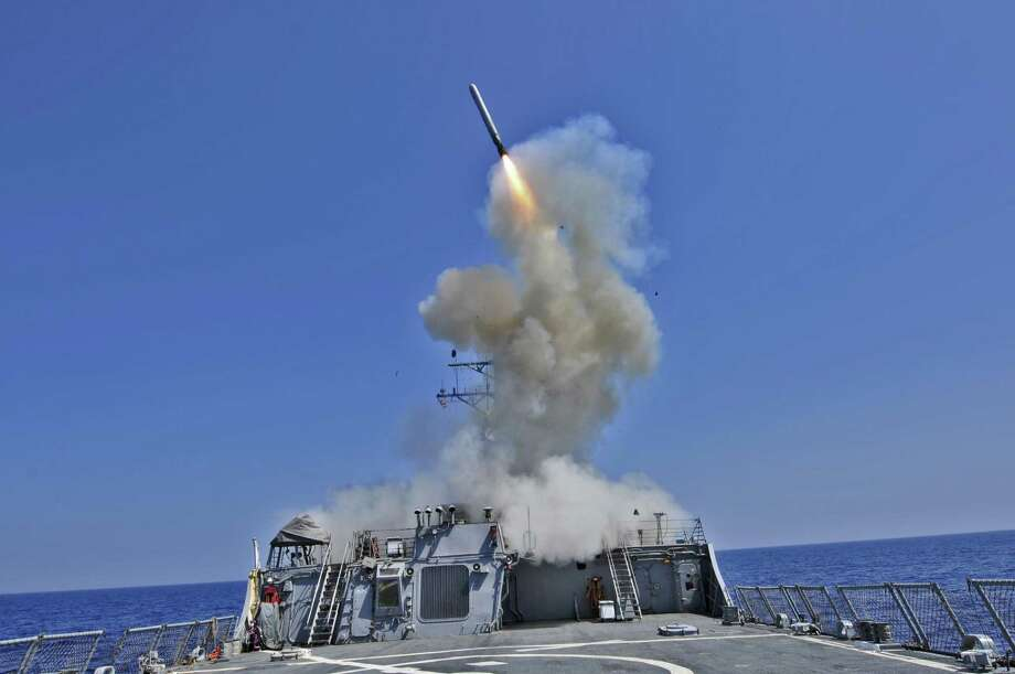 The USS Barry, also available for action against Syria, launches a Tomahawk cruise missile Libya in 2011. Photo: File