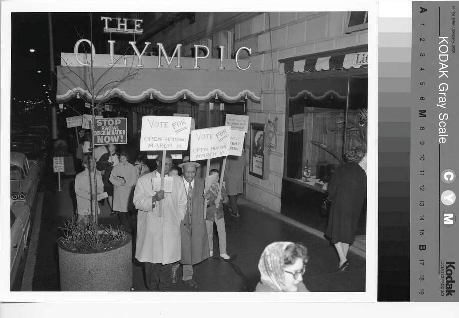 Civil rights marchers in front of Olympic Hotel, Seattle, 1964.