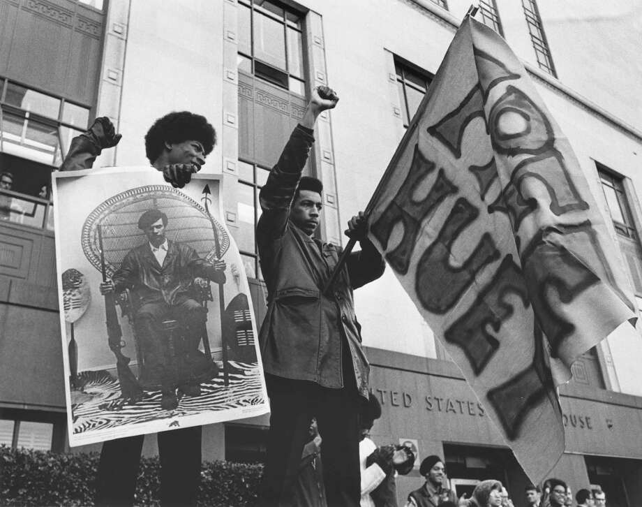 Black Panther demonstration at Federal Building for release of Black Panthers co-founder Huey Newton, 1969. He was convicted in California of voluntary manslaughter, but the decision was overturned in 1970. Photo: Tom Barlet/Copyright MOHAI, Seattle Post-Intelligencer Collection, 1986.5.52268 Photo: Tom Barlet, Copyright MOHAI, Seattle Post-Intelligencer Collection / Copyright Museum of History & Industry
