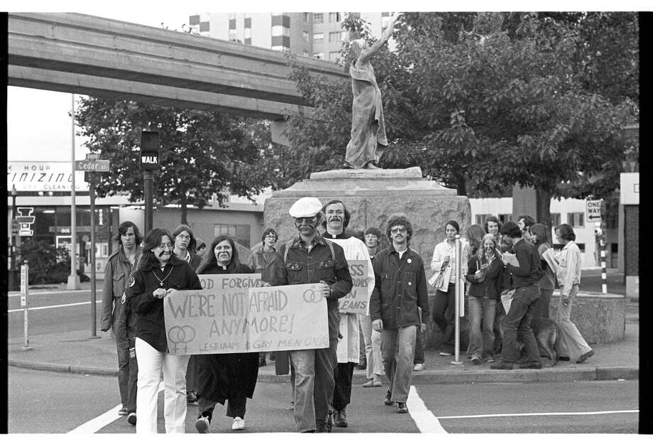 Gay demonstrators cross Cedar Street in front of Chief Seattle statue, July 1973.  Photo: Robert H. Miller/Copyright MOHAI, Seattle Post-Intelligencer Collection, 2002.46.598.1 Photo: Robert H. Miller, Copyright MOHAI, Seattle Post-Intelligencer Collection / Copyright Museum of History & Industry