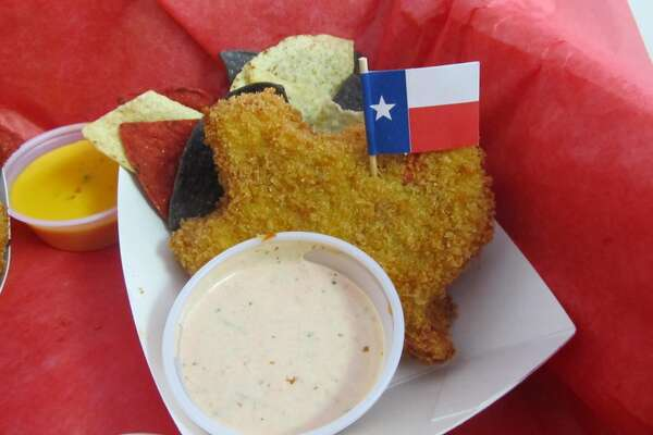 "Fernie's Deep Fried King Ranch Casserole –This stick-to-your-ribs TEXAS SHAPED creation is melted cheese, salty, spicy, goodness that is dipped in a zesty southwestern egg wash and coated in panko bread crumbs.  Deep fried golden brown and crunchy on the outside; steamy and creamy on the inside! Served with a side of red, white, and blue tortilla chips and your choice of our homemade ""salsafied"" sour cream or cheesy queso.  Each one proudly flying the flag of the Lone Star State and deep fried in the Heart of Texas!"