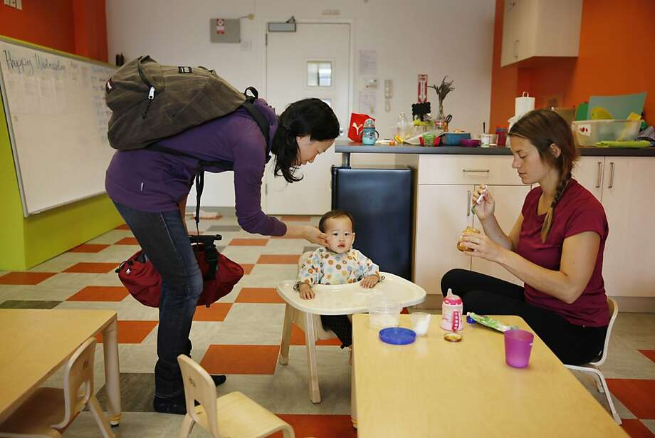 Annie Fu (l to r) bids her daughter Autumn Liu, 10 months, goodbye as NextKids caregiver Kristen Portney prepares to give Autumn some lunch at NextKids on Wednesday, August 21, 2013 in San Francisco, Calif. Photo: Lea Suzuki, The Chronicle