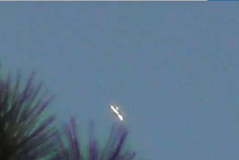 "On Aug. 21 Margaret Pfeiffer, who lives in west central Georgia saw an unidentified falling object and captured it on video. ""I captured this after the fire from across the street here,"" Pfeiffer described on YouTube. ""Say what you will, but this has no wings as a plane would have. Watch in full screen and keep pausing. There isn't even a shadow for the wing area. I believe this is a drone or UFO!!""From Youtube video: August,21,2013 This Is Not A Plane !!! Photo: Jacobson, Hannah, Multi"