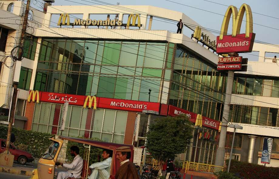 A McDonald's Corp. outlet stands in Karachi, Pakistan, on Saturday, Jan. 5, 2013. Photo: Asim Hafeez, Bloomberg / © 2013 Bloomberg Finance LP