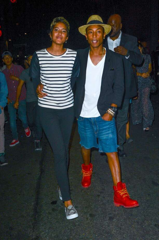 Rapper Pharrell Williams (R) and Helen Lasichanh leave the Dream Downtown hotel on August 25, 2013 in New York City.  (Photo by Ray Tamarra/Getty Images) Photo: Ray Tamarra, Getty Images