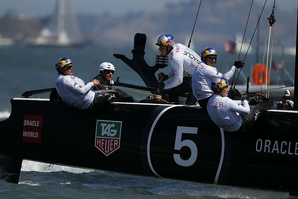 Oracle Team USA Coutts, skippered by Sir Russell Coutts, left, pulls a rope during America's Cup World Series match racing final against Oracle Team USA Spithill in San Francisco Bay, Calif. on Sunday, Aug. 26, 2012.