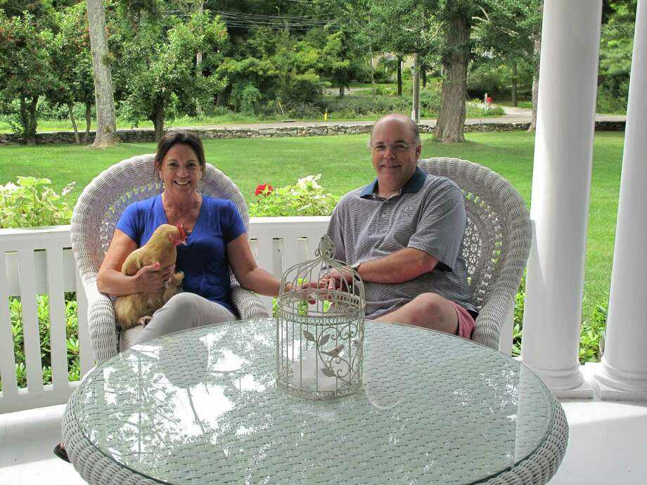 Debbie and Kevin McQuilkin sit on their porch at 757 Oenoke Ridge. The couple bought the house, which was built in 1886, two years ago. Aug. 23, 2013, New Canaan, Conn. Photo: Tyler Woods