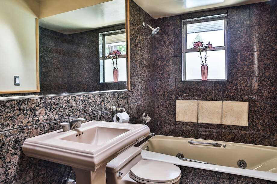 Bathroom, with Jacuzzi, of 3916 S.W. Webster St. It's listed for $434,950. Photo: Majanoue Groulx, John L. Scott Real Estate