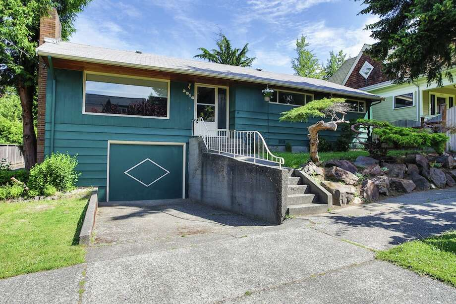 Gatewood is full of updated mid-century homes, and convenient to Lincoln Park and West Seattle Junction. Here are three houses listed there for $400,000 to $475,000, starting with 3916 S.W. Webster St. The 2,700-square-foot house, built in 1953, has three bedrooms, 1.75 bathrooms, skylights, a Jacuzzi and a swimming pool with a spa on a 5,712-square-foot lot. It's listed for $434,950. Photo: Majanoue Groulx, John L. Scott Real Estate