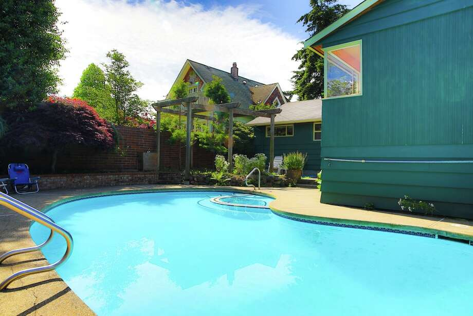 Pool and yard of 3916 S.W. Webster St. It's listed for $434,950. Photo: Majanoue Groulx, John L. Scott Real Estate